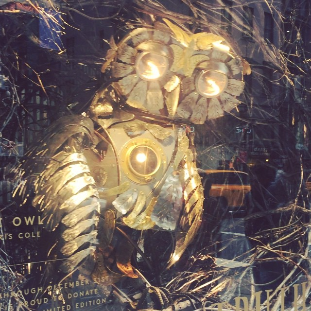 The windows at Barney's are beyond rad. One has a performance art ice skater in a Thor helmet, the  other has this giant steampunk owl offering a spoken word recitation of Madonna's