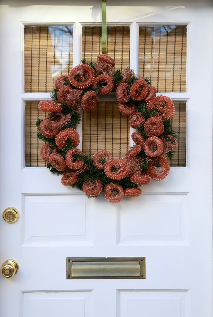 copper scrubber wreath white door